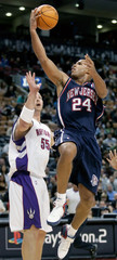New Jersey Nets forward Jefferson drives to the hoop past past Toronto Raptors' Rafael Arujo in Toronto