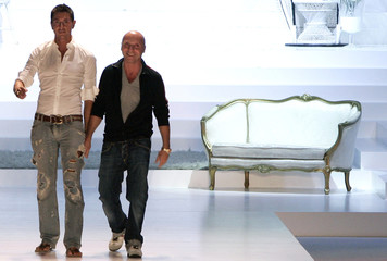 Italian designers Gabbana and Dolce acknowledge applause in Milan
