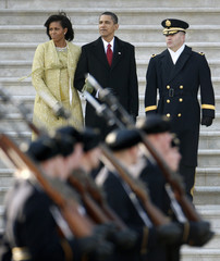 U.S. President Barack Obama and first lady Michelle watch the military parade at the U.S. Capitol during the inauguration ceremony in Washington