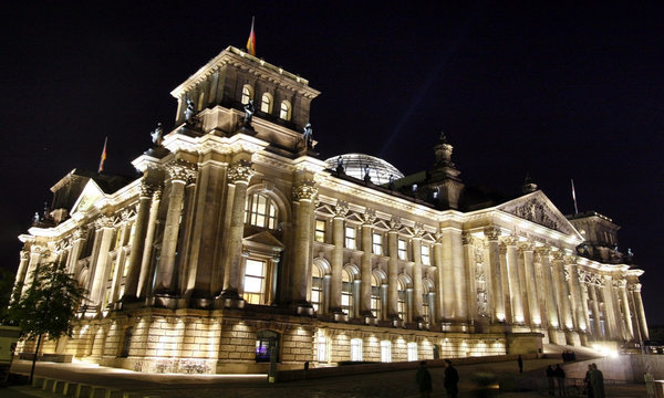Streams of light beam from the cupola of the Reichstags building as the facade is illuminated by energy saving lamps in Berlin