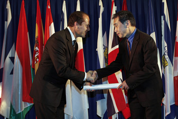 Mayor of Jerusalem shakes hands with writer Haruki Murakami in Jerusalem