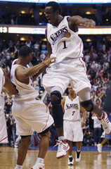 Philadelphia 76ers center Samuel Dalembert celebrates a win over the Denver Nuggets with teammate Willie Green in Philadelphia