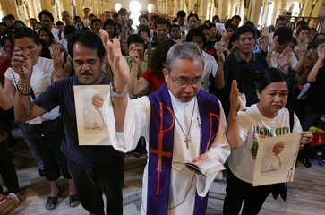 A Filipino priest officiates a mass to pray for Pope John Paul in Manila.