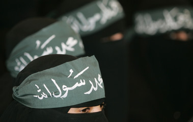 Veiled women attend a rally in Sanaa against the recent reproduction of cartoons depicting Prophet Mohammad by Danish newspapers
