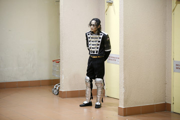 A Michael Jackson impersonator waits for his turn to perform during a tribute to the late pop icon at a shopping mall in Kuala Lumpur