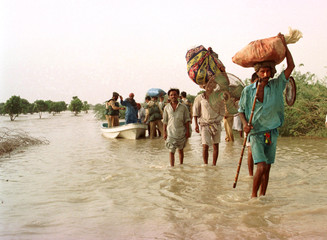 PEOPLE EVACUATE AFTER A BREACH IN A CANAL IN PAKISTAN.