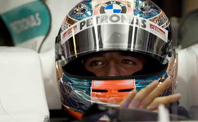 BMW-Sauber Formula One driver Robert Kubica of Poland sits in his car in the pits during the third practice session of the Abu Dhabi F1 Grand Prix at the Yas Marina circuit