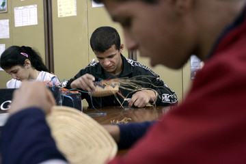 A mentally handicapped children learns to weave baskets at an educational psychology centre affiliated to Mutual Aid Association at Algiers
