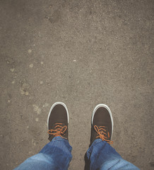 Top view from Young man with sneakers and jeans