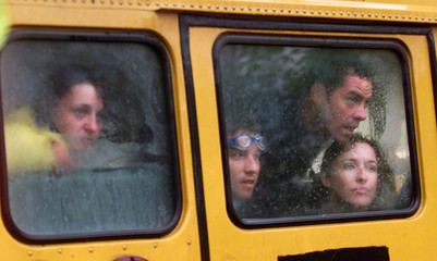 Arrested protesters gaze out from a bus as they watch police arrest other demonstrators during their..