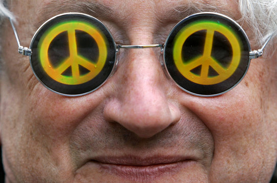 A protestor wears sunglasses with a peace sign during a demonstration in Munich.
