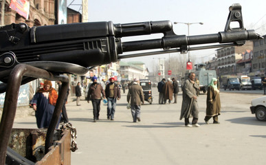 A policeman holds a rifle ahead of India's Republic Day celebrations in Srinagar