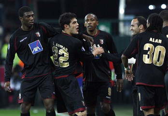 Braga's Aguiar celebrates with team mates after scoring a goal during their UEFA Cup soccer match against Standard Liege in Liege