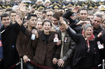 Relatives of fallen Turkish soldier Huseyin Dogan mourn during his funeral at Kocatepe Mosque in Ankara