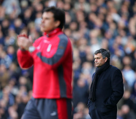 Fulham's manager Coleman and Chelsea's manager Mourinho watch their sides play during their English Premier League match in London