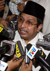 Former Indonesian minister of religion Said Agil Munawar speaks to journalists in a Jakarta courtroom