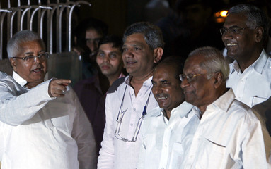 India's Railways Minister Yadav speaks as Defence Minister Antony and senior communist leaders listen to him in New Delhi