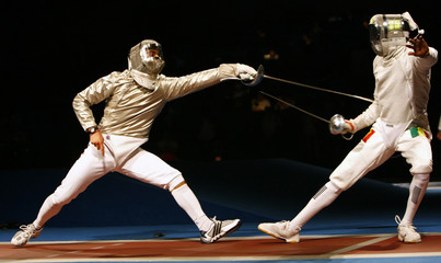 Rogers of the U.S. competes against Thiam of Senegal during their men's individual sabre fencing competition at the Beijing 2008 Olympic Games