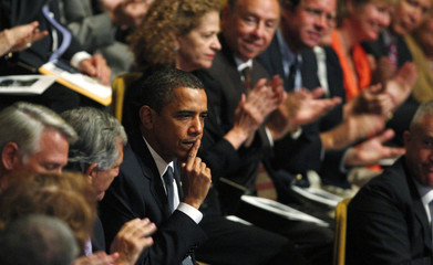 US President Barack Obama is applauded at a memorial service for journalist Cronkite in New York