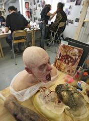 Latex masks and body parts await makeup artists on the set of the horror movie 'Dark Floors' in Oulu