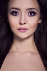 Portrait of a beautiful woman in an evening makeup.