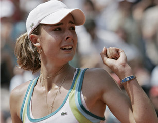Cornet of France celebrates after winning against Colombia's Mariana Duque Marino in the girls junior's final match at the French Open tennis tournament in Paris