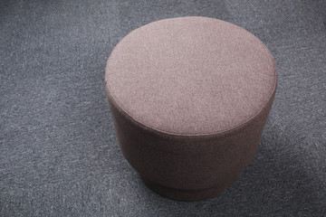 Top view of stool sitting on gray floor.
