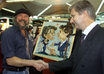BELGIAN CROWN PRINCE PHILIPPE RECEIVES A CARTOON DURING A VISIT ATBUSWORLD FAIR IN KORTRIJK.