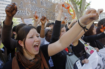French high school students shout slogans during a demonstration in Marseille