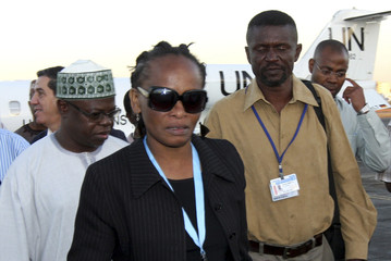 Freed civilian peacekeepers Ncube and Winful arrive at the airport in Khartoum