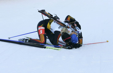 Germany's Apel and her compatriot Glagow pause after the women's 12.5 km mass start race at the Biathlon World Cup in Oberhof