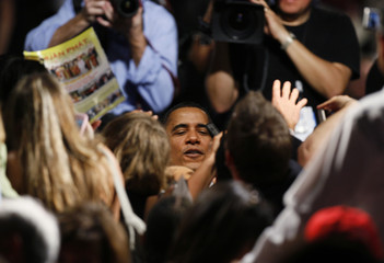 U.S. President Barack Obama is mobbed by the audience after speaking at a town hall meeting in Costa Mesa