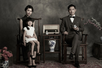 Classical style of a family of three photo
