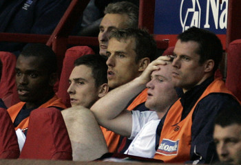 England's  Rooney  holds head after being substituted against  Macedonia during Euro 2008 qualifying match in Manchester