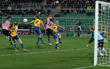 Palermo defender Rinaudo scores past Brondby's goalkeeper Ankergren during UEFA Cup match in Palermo