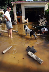 A resident of Vestric near Nimes inspects the damage to his house following heavy rains in the ...