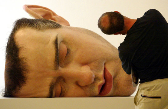 A visitor to the Museum of Contemporary Art in Sydney December 20, 2002 strikes an unusual pose whil..