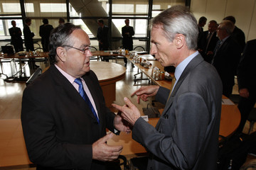 Vardanega, PSA Peugeot Citroen's advisor to the Chairman of the Managing Board, speaks with Senard, Michelin managing partner and finance chief, before a meeting in Paris