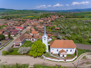 Talisoara Olasztelek  village Church in Covasna County, Transylvania, Romania aerial view