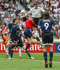 Argentina's goalkeeper Abbondanzieri and Germany's Miroslav Klose jump for the ball during their World Cup 2006 quarter-final soccer match in Berlin