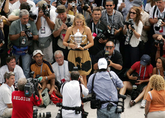 Russia's Sharapova poses with women's U.S. Open trophy at Arthur Ashe stadium at U.S. Open in New York