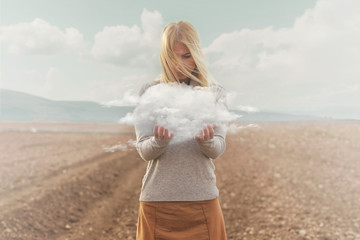 surreal moment , woman holding in her hands a soft cloud