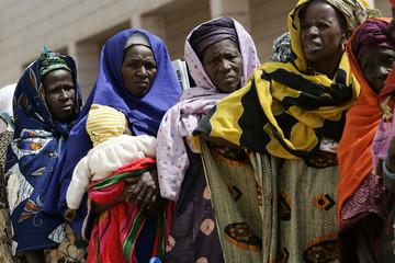 Women wait in line to enter sport hall hosting World Social Forum in Bamako