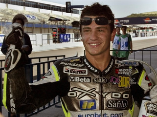 FRENCH 250CC RACER RANDY DE PUNIET CELEBRATES AFTER CLAIMING THE POLEPOSITION FOR SPANISH GRAND PRIX ...