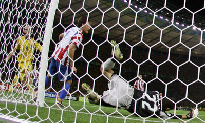 Sweden's Ljungberg scores his team's first goal as Paraguay's goalkeeper Bobadilla lunges for the ball during their Group B World Cup 2006 soccer match in Berlin