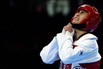 South Korea's Kim celebrates after winning the men's under-62kg gold medal at World Taekwondo ...