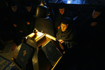 Romanian Orthodox nuns attend the Maundy Thursday religious service at Pasarea monastery near Bucharest