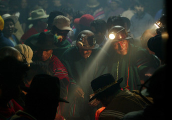 Bolivian miners gather inside Hitos mine during traditional ceremony on the outskirts of Oruro