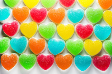 Heart candies coated with sugar, heart colorful sweet candies, sugar heart shaped candy
