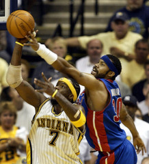 DETROIT PISTONS WALLACE DEFLECTS SHOT OVER INDIANA PACERS O'NEAL IN GAME 5.